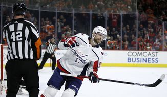Washington Capitals' Evgeny Kuznetsov (92) celebrates after scoring a goal against Philadelphia Flyers' Carter Hart during a shootout in an NHL hockey game, Wednesday, Nov. 13, 2019, in Philadelphia. Washington won 2-1. (AP Photo/Matt Slocum)