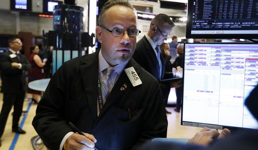 FILE - In this Nov. 7, 2019, file photo trader Robert Arciero works on the floor of the New York Stock Exchange. The U.S. stock market opens at 9:30 a.m. EST on Wednesday, Nov 13. (AP Photo/Richard Drew, File)