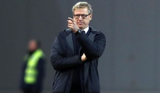 FILE - In this file photo dated Thursday, Nov. 15, 2018, Finland's coach Markku Kanerva during the UEFA Nations League soccer match between Greece and Finland at Olympic stadium in Athens.  Finland could seal a place in the finals of next year's European Championship for the first time in its history on upcoming Friday Nov. 15, 2019, if they beat Liechtenstein at home.  It's a day many in this Nordic country thought would never arrive after so many past disappointments but Finland's ex-school teacher coach Markku Kanerva could be changing the mentality of a nation. (AP Photo/Thanassis Stavrakis, FILE)