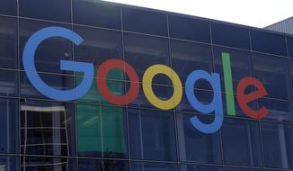 FILE - In this Sept. 24, 2019, file photo a sign is shown on a Google building at their campus in Mountain View, Calif. Google plans offer checking accounts run by Citigroup and a credit union, according to a report by The Wall Street Journal. (AP Photo/Jeff Chiu, File)