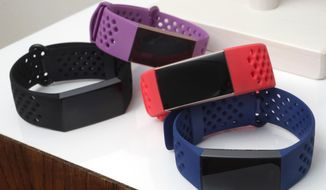 FILE - In this Aug. 16, 2018, file photo, the new Fitbit Charge 3 fitness trackers with sport bands are displayed in New York. Nine privacy, social justice and consumer groups are calling for the U.S. federal government to block Google's $2.1 billion acquisition of fitness-gadget maker Fitbit, citing antitrust and privacy concerns. (AP Photo/Richard Drew, File)