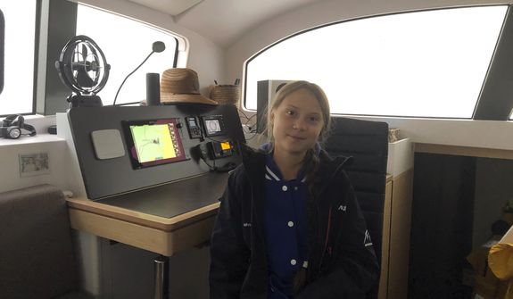 Greta Thunberg, a 16-year-old climate activist from Sweden, sits on a catamaran docked in Hampton, Va., on Tuesday, Nov. 12, 2019. Thunberg will leave North America and begin her return trip across the Atlantic on Wednesday aboard a 48-foot (15-meter) catamaran sailboat whose passengers include an 11-month-old baby.The boat leaves little to no carbon footprint, boasting solar panels and a hydro-generators for power. (AP Photo/Ben Finley)