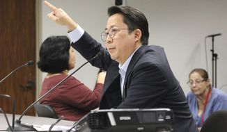 Honolulu County Clerk Glen Takahashi speaks to lawmakers at a briefing at the Hawaii State Capitol in Honolulu, on Wednesday, Nov. 13, 2019. Elections officials are warning that shifting to voting by mail won't mean that Hawaii election results will be available sooner. (AP Photo/Audrey McAvoy)