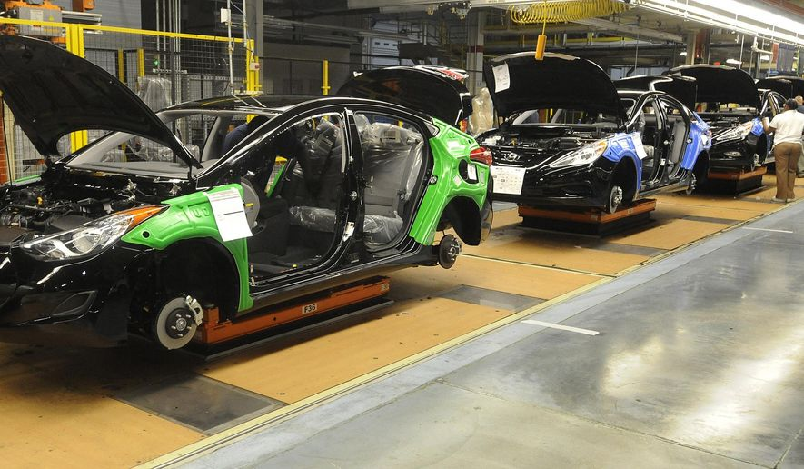 FILE - In this Jan. 27, 2011, file photo, a Hyundai Elantra, left, and Hyundai Sonatas move down the assembly line in the Hyundai manufacturing plant in Montgomery, Ala. Hyundai will build a pickup-style sport-utility vehicle at its plant in Alabama, which the company said Wednesday, Nov. 13, 2019,  is being enlarged in a $410 million expansion project. (Mickey Welsh/Montgomery Advertiser via AP)