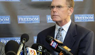 FILE - In this Feb. 2, 2018, file photo, Douglas Haig takes questions from reporters at a news conference in Chandler, Ariz. Haig plans to plead guilty in a federal case in Nevada alleging he illegally manufactured ammunition sold to the gunman who carried out the Las Vegas Strip massacre in October 2017. A court notice posted Tuesday, Nov. 12, 2019, set a change-of-plea hearing next week for Haig in Las Vegas, ahead of trial scheduled next month. (AP Photo/Brian Skoloff, File)
