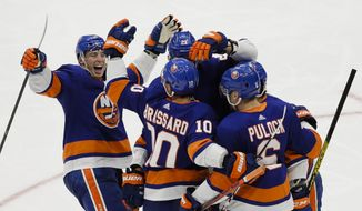 New York Islanders' Derick Brassard (10) celebrates with teammates after scoring a goal during the third period of an NHL hockey game against the Toronto Maple Leafs Wednesday, Nov. 13, 2019, in Uniondale, N.Y. The Islanders won 5-4. (AP Photo/Frank Franklin II)