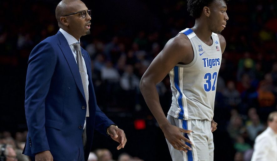 Memphis coach Penny Hardaway, left, talks to center James Wiseman during the second half of the team's NCAA college basketball game against Oregon in Portland, Ore., Tuesday, Nov. 12, 2019. Oregon won 82-74. (AP Photo/Craig Mitchelldyer)