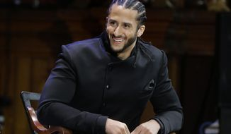 In this Oct. 11, 2018, file photo, former NFL football quarterback Colin Kaepernick smiles on stage during W.E.B. Du Bois Medal ceremonies at Harvard University, in Cambridge, Mass. Kaepernick plans to audition for NFL teams on Saturday, Nov. 16, 2019, in a private workout arranged by the league to be held in Atlanta. (AP Photo/Steven Senne, File) **FILE**