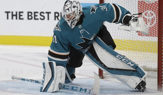 San Jose Sharks goalie Martin Jones deflects a shot from the Edmonton Oilers during the second period of an NHL hockey game Tuesday, Nov. 12, 2019, in San Jose, Calif. (AP Photo/Ben Margot)