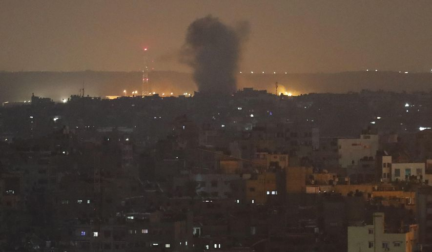 An explosion caused by Israeli airstrikes is seen in Gaza City, early Thursday, Nov. 14, 2019. Israeli aircraft struck Islamic Jihad targets throughout the Gaza Strip on Wednesday while the militant group rained scores of rockets into Israel for a second straight day as the heaviest round of fighting in months showed no signs of ending. (AP Photo/Adel Hana)