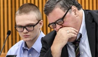 Jesse Osborne talks with attorney Frank Eppes during a sentence-related hearing at the Anderson County Courthouse, Wednesday, Nov. 13, 2019, in Anderson, S.C.  Osborne, a teen who killed his father at home before fatally shooting a first-grader on a South Carolina elementary school playground, is either a traumatized son who can be rehabilitated or a dangerous and pathological liar with no remorse, according to the conflicting testimony of two mental health professionals Wednesday.  (Ken Ruinard/The Independent-Mail via AP)