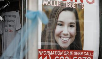 FILE - In this Aug. 21, 2018, file photo, a poster for then missing University of Iowa student Mollie Tibbetts hangs in the window of a local business in Brooklyn, Iowa. Lawyers for the man charged with killing Tibbetts are asking a judge to throw out evidence discovered during a faulty interrogation, including the victim's body. A court hearing is scheduled Wednesday, Nov. 13, 2019, to consider the matter. (AP Photo/Charlie Neibergall, File)