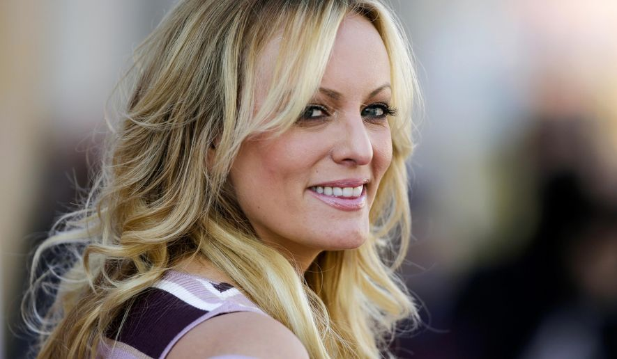 "In this Oct. 11, 2018, file photo, adult film actress Stormy Daniels attends the opening of the adult entertainment fair ""Venus,"" in Berlin. (AP Photo/Markus Schreiber, File)"