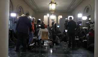 Members of the media set up to cover the House public impeachment hearings Wednesday, Nov. 13, 2019, on Capitol Hill in Washington. With the bang of a gavel, House Intelligence Committee Chairman Adam Schiff will open the hearings into President Donald Trump's pressure on Ukraine to investigate political rivals. (AP Photo/Jacquelyn Martin)