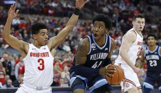Villanova's Saddiq Bey (41) looks for an open shot against Ohio State's D.J. Carton during the first half of an NCAA college basketball game Wednesday, Nov. 13, 2019, in Columbus, Ohio. (AP Photo/Jay LaPrete)