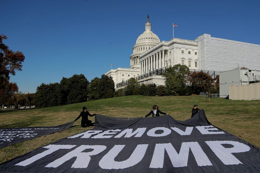 Some 56% of Americans disapprove of the job that Congress is doing, according to a new poll from The Economist and YouGov. Demonstrators kneel near large banners on the lawn adjacent to the U.S. Capitol, while a top U.S. diplomat in Ukraine William Taylor, and career Foreign Service officer George Kent, testify before the House Intelligence Committee on Capitol Hill in Washington, Wednesday, Nov. 13, 2019, during the first public impeachment hearings of President Donald Trump's efforts to tie U.S. aid for Ukraine to investigations of his political opponents. (AP Photo/Julio Cortez) (ASSOCIATED PRESS)