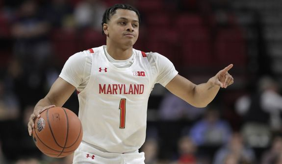 Maryland guard Anthony Cowan Jr. attacks on Rhode Island during the first half of an NCAA college basketball game, Saturday, Nov. 9, 2019, in College Park, Md. (AP Photo/Julio Cortez) ** FILE **