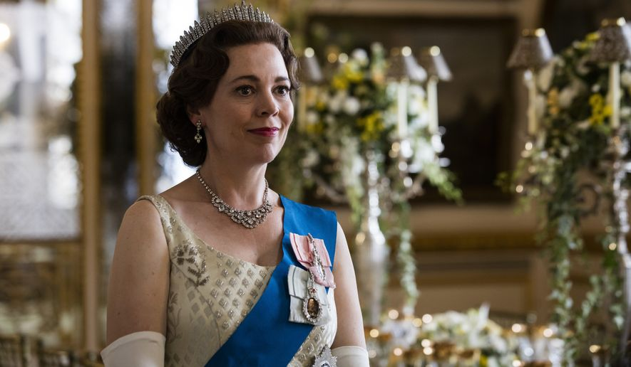 """In this image released by Netflix, Olivia Colman portrays Queen Elizabeth II in a scene from the third season of """"The Crown,""""  debuting Sunday on Netflix. (Sophie Mutevelian/Netflix via AP)"""