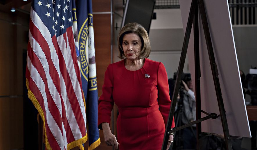 "Speaker of the House Nancy Pelosi, D-Calif., leaves a news conference the morning after the first public hearing in the impeachment probe of President Donald Trump on his effort to tie U.S. aid for Ukraine to investigations of his political opponents, on Capitol Hill in Washington, Thursday, Nov. 14, 2019. Pelosi says the president's actions in the impeachment inquiry amount to ""bribery."" (AP Photo/J. Scott Applewhite)"
