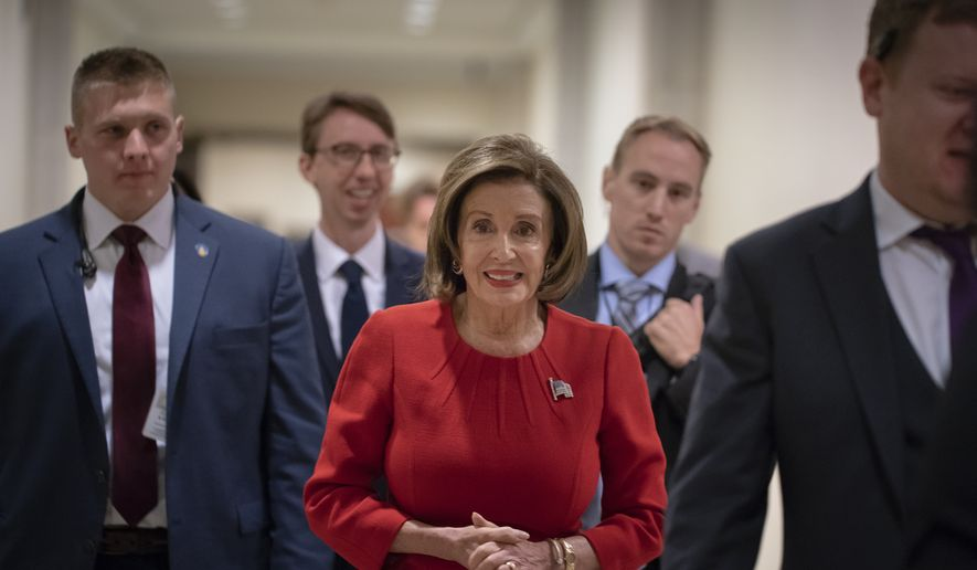 "Speaker of the House Nancy Pelosi, D-Calif., arrives to talk to reporters on the morning after the first public hearing in the impeachment probe of President Donald Trump on his effort to tie U.S. aid for Ukraine to investigations of his political opponents, on Capitol Hill in Washington, Thursday, Nov. 14, 2019. Pelosi says the president's actions in the impeachment inquiry amount to ""bribery."" (AP Photo/J. Scott Applewhite)"