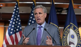 House Republican Leader Kevin McCarthy, R-Calif., speaks to reporters on the morning after the first public hearing in the impeachment probe of President Donald Trump on his effort to tie U.S. aid for Ukraine to investigations of his political opponents, on Capitol Hill in Washington, Thursday, Nov. 14, 2019. (AP Photo/J. Scott Applewhite)