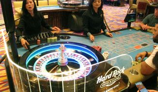This June 20, 2019 photo shows a game of roulette underway at the Hard Rock casino in Atlantic City N.J. At a state Assembly committee hearing on Thursday, Nov. 14 some New Jersey officials wondered if they should impose a cap on the number of casinos allowed to operate in Atlantic City, to protect the health of the nine currently in business. (AP Photo/Wayne Parry)