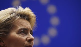 Incoming European Commission President Ursula von der Leyen talks to European Commission Vice-President Frans Timmermans prior a ceremony to mark the 30th anniversary of the fall of the Berlin Wall, at the European Parliament in Brussels, Wednesday, Nov. 13, 2019. (AP Photo/Francisco Seco)