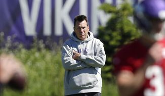 FILE - In this June 13, 2019, file photo, Minnesota Vikings assistant head coach and offensive advisor Gary Kubiak watches quarterbacks during drills at the team's NFL football training facility in Eagan, Minn. Kubiak's addition to the Minnesota Vikings coaching staff as a senior adviser has made a clear positive impact. This week, the Vikings host his long-time employer, the Denver Broncos, the team he served as head coach for in the 2015-16 seasons. (AP Photo/Andy Clayton- King, File)