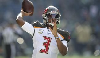 Tampa Bay Buccaneers quarterback Jameis Winston passes during warmups before an NFL football game against the Seattle Seahawks, Sunday, Nov. 3, 2019, in Seattle. (AP Photo/Scott Eklund) ** FILE **