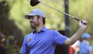 Louis Oosthuizen of South Africa prepares to tee off during the HSBC Champions golf tournament at the Sheshan International Golf Club in Shanghai on Friday, Nov. 1, 2019. (AP Photo/Ng Han Guan)
