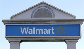 In this Sept. 3, 2019, file photo, a Walmart logo forms part of a sign outside a Walmart store, in Walpole, Mass. (AP Photo/Steven Senne, File)