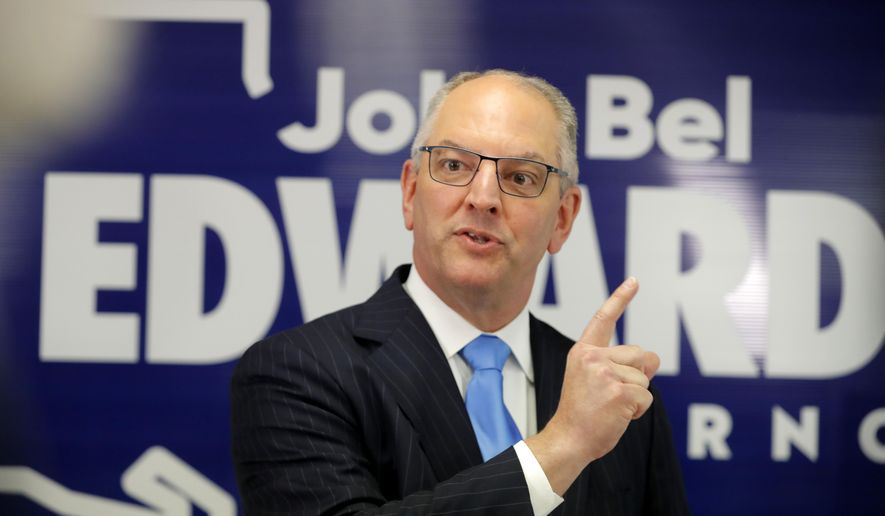 Louisiana Gov. John Bel Edwards talks to media at his campaign office in Shreveport, La., Thursday, Nov. 14, 2019.  (AP Photo/Gerald Herbert)