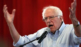 FILE - In this Saturday, July 6, 2019 file photo Democratic presidential candidate Sen. Bernie Sanders, I-Vt., speaks during a town hall meeting at the Victory Missionary Baptist Church in Las Vegas. Sanders' campaign says the Vermont senator is trying in Nevada to court moderate Democrats, Latinos and voters who might not be very politically engaged. Sanders' senior adviser Jeff Weaver also told reporters on a phone call Thursday, Nov. 14, 2019, that the presidential candidate will begin airing television ads in Nevada in the coming weeks. (Steve Marcus/Las Vegas Sun via AP,File)