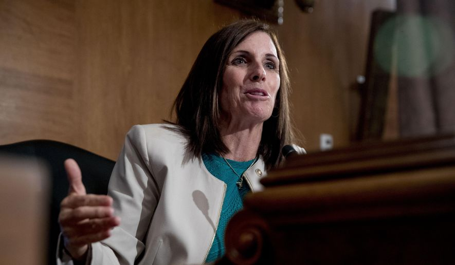 In this Sept. 10, 2019, file photo, Sen. Martha McSally, R-Ariz., speaks at a Senate Banking Committee hearing on Capitol Hill in Washington. Ms. McSally is facing a tough 2020 election challenge from Democrat Mark Kelly. (AP Photo/Andrew Harnik, File)