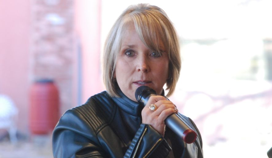 New Mexico Gov. Michelle Lujan Grisham, talks at the Randall Davey Audubon Center on the outskirts of Santa Fe, N.M. on Thursday, Nov. 14, 2019. Grisham signed a shared stewardship pact with the U.S. Forest Service, aimed at a closer state-federal relationship when it comes to improving forest health and risk management related to wildfires and drought.(AP Photo/Morgan Lee)