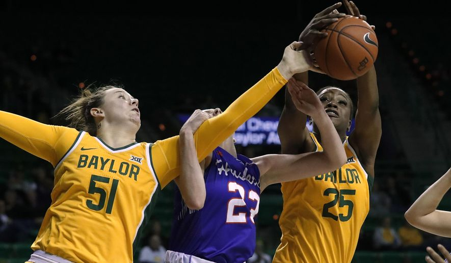 Baylor forward Caitlin Bickle (51) and center Queen Egbo (25) compete against Houston forward Lauren Calver, center, for a rebound during the second half of an NCAA college basketball game in Waco, Texas, Thursday, Nov. 14, 2019. (AP Photo/Tony Gutierrez)