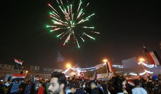 Anti-government protesters celebrate a soccer match win in Tahrir Square in Baghdad, Iraq, Thursday, Nov. 14, 2019. Iraqis are celebrating a 2-1 win over Iran in a much-anticipated World Cup qualifying match. (AP Photo/Hadi Mizban)