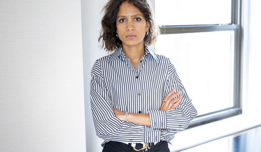 """This Oct. 15, 2019 photo shows Mati Diop posing for a portrait in New York to promote her film """"Atlantics."""" Diop made history earlier this year as the first black woman to direct a film in competition at the Cannes Film Festival. (Photo by Scott Gries/Invision/AP)"""