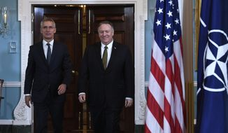 Secretary of State Mike Pompeo, right, and NATO Secretary General Jens Stoltenberg, left, walk together for a photo opportunity at the State Department in Washington, Thursday, Nov. 14, 2019. (AP Photo/Susan Walsh)