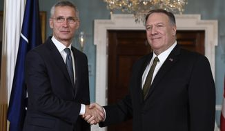 Secretary of State Mike Pompeo, right, shakes hands with NATO Secretary General Jens Stoltenberg, left, as they pose for a photo at the State Department in Washington, Thursday, Nov. 14, 2019. (AP Photo/Susan Walsh)