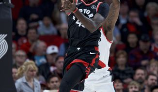 Toronto Raptors forward Pascal Siakam (43) passes the ball away from Portland Trail Blazers guard Rodney Hood during the first half of an NBA basketball game in Portland, Ore., Wednesday, Nov. 13, 2019. (AP Photo/Craig Mitchelldyer)