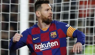 Barcelona's Lionel Messi celebrates scoring his side's first goal with a penalty during a Spanish La Liga soccer match between Barcelona and Celta at Camp Nou stadium in Barcelona, Saturday, Nov. 9, 2019. (AP Photo/Joan Monfort)