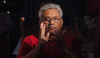 FILE - In this Wednesday, Nov. 13, 2019, file photo, Sri Lanka's former defense secretary and presidential candidate Gotabaya Rajapaksa attends a rally in Homagama, on the outskirts of Colombo, Sri Lanka. With a record 35 candidates vying for the presidency, Rajapaksa, a former defense official under his brother, ex-President Mahinda Rajapaksa, was widely expected to triumph over ruling party Housing Minister Sajith Premadasa. But as the election approaches, the race has become very close.  (AP Photo/Eranga Jayawardena, File)