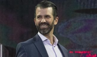 Donald Trump Jr. gives a thumbs up to an audience member after a panel discussion at a Liberty University Convocation, Wednesday, Nov. 13, 2019, in Lynchburg, Va. (AP Photo/Don Petersen)