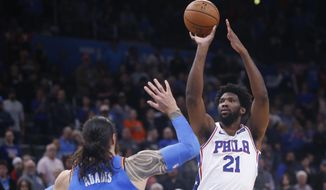 Philadelphia 76ers center Joel Embiid (21) shoots over Oklahoma City Thunder center Steven Adams, left, in the first half of an NBA basketball game Friday, Nov. 15, 2019, in Oklahoma City. (AP Photo/Sue Ogrocki)