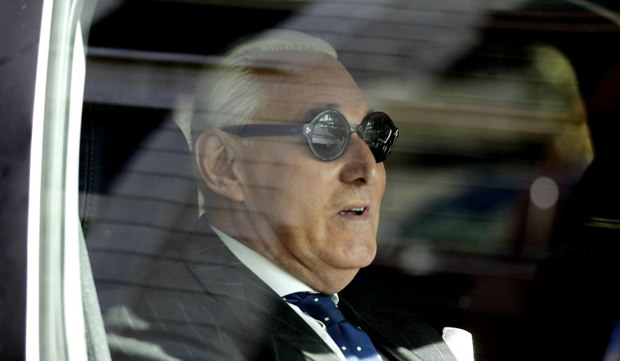 Roger Stone sits in a vehicle while leaving federal court Washington, Friday, Nov. 15, 2019. Stone, a longtime friend of President Donald Trump, has been found guilty at his trial in federal court in Washington. (AP Photo/Julio Cortez) ** FILE **