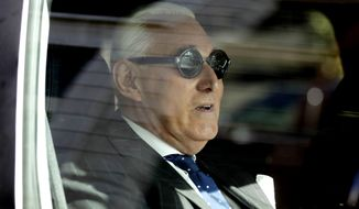 Roger Stone sits in a vehicle while leaving federal court Washington, Friday, Nov. 15, 2019. Stone, longtime friend of President Donald Trump, has been found guilty at his trial in federal court in Washington. (AP Photo/Julio Cortez)