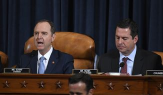 House Intelligence Committee Chairman Adam Schiff, D-Calif., left, and ranking member Rep. Devin Nunes, R-Calif., give opening remarks at the start of the hearing with former U.S. Ambassador to Ukraine Marie Yovanovitch before the House Intelligence Committee on Capitol Hill in Washington, Friday, Nov. 15, 2019, in the second public impeachment hearing of President Donald Trump's efforts to tie U.S. aid for Ukraine to investigations of his political opponents. (AP Photo/Susan Walsh)