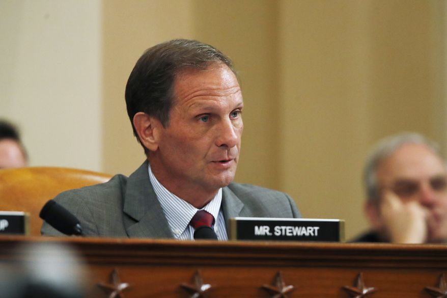 Rep. Chris Stewart, R-Utah, questions former Ambassador to Ukraine Marie Yovanovitch as she testifies before the House Intelligence Committee on Capitol Hill in Washington, Friday, Nov. 15, 2019, during the second public impeachment hearing of President Donald Trump's efforts to tie U.S. aid for Ukraine to investigations of his political opponents. (AP Photo/Alex Brandon)