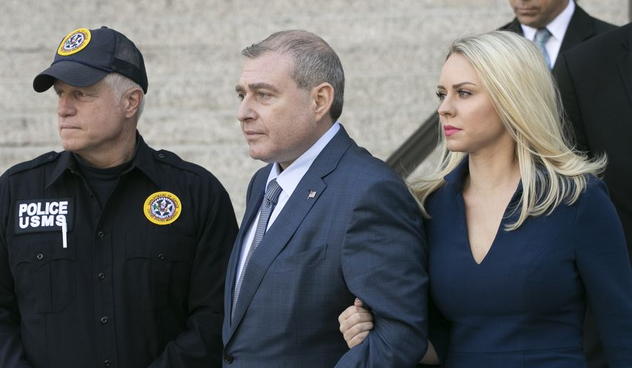 Lev Parnas leaves his arraignment with his wife, Svetlana Parnas, Wednesday, Oct. 23, 2019 in New York. He and Igor Fruman are charged with conspiracy to make illegal contributions to political committees supporting President Donald Trump and other Republicans. Prosecutors say the pair wanted to use the donations to lobby U.S. politicians to oust the country's ambassador to Ukraine. (AP Photo/Mark Lennihan)